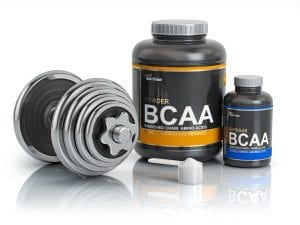 BCAA branched-chain amino acid with scoop and dumbbell.Bodybuil