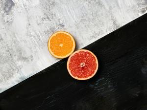 Grapefruit citrus fruit halves on wooden