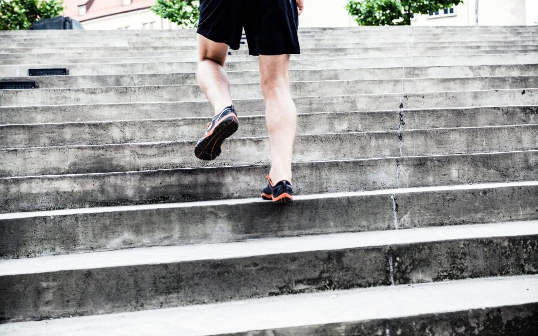 Man running on stairs, training