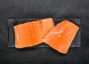 Red Salmon Fish Fillet Raw on black board
