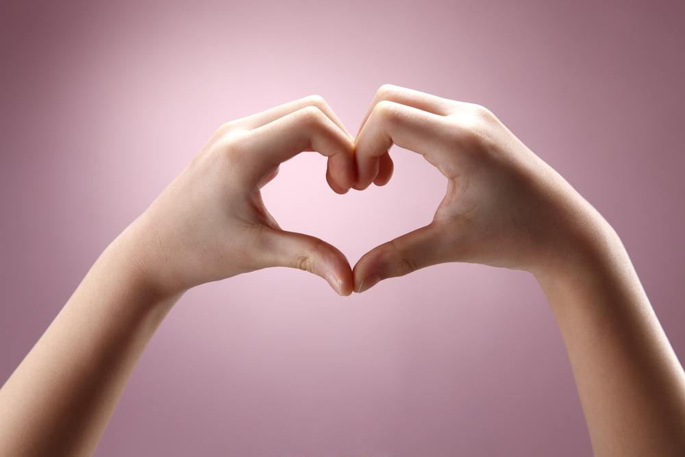 heart hands with pink background